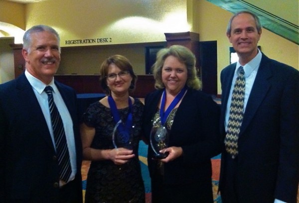 Leslie and Mindy with their husbands, Peter and John, after winning the 2012 Christy Award for The Amish Midwife