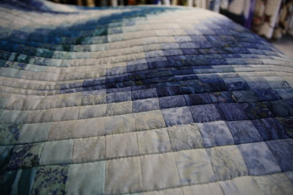 Photo: Mindy's favorite quilt in the Amish quilt shop where she researched The Amish Quilter
